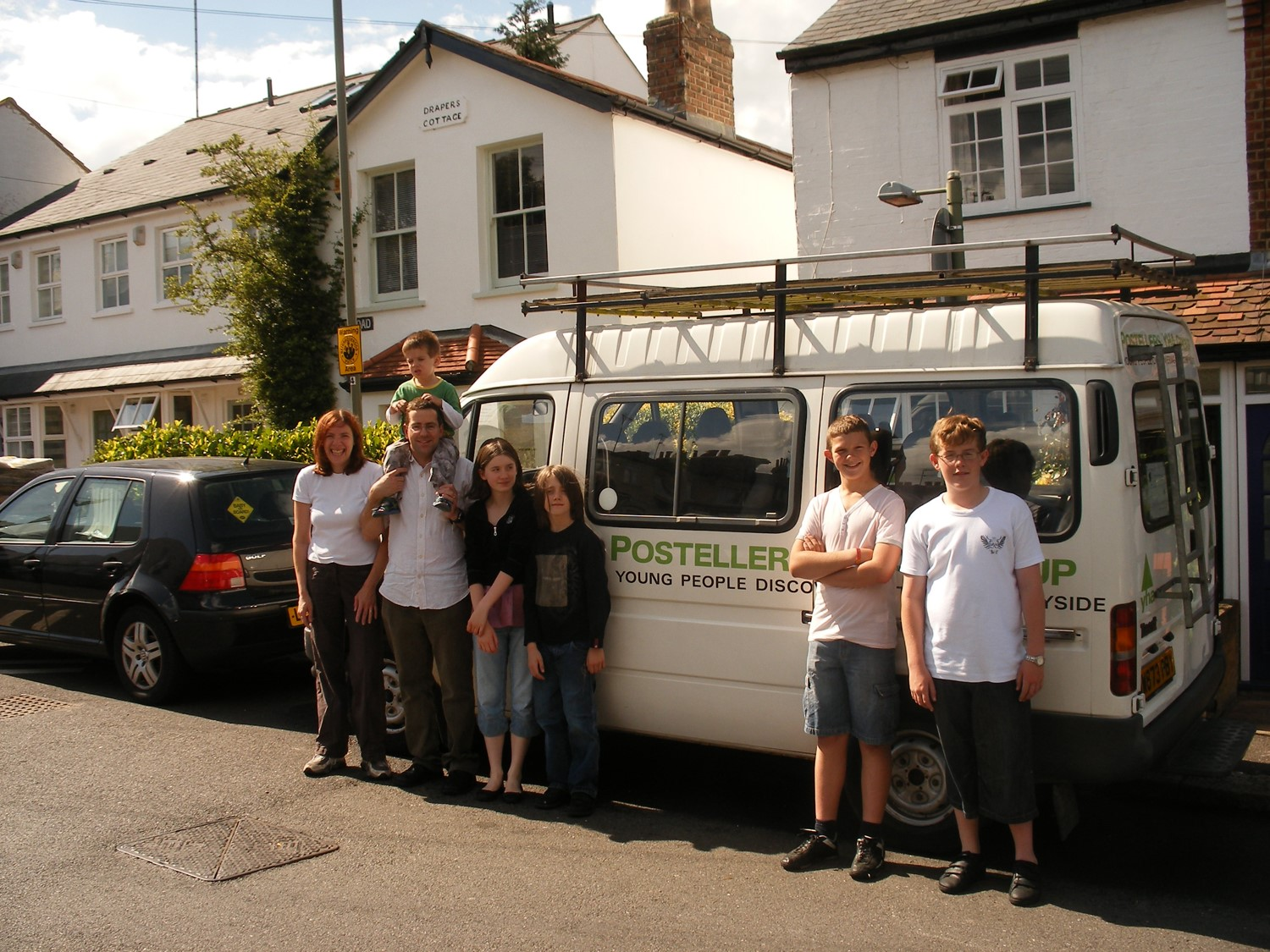 Some of the Postellers YHA Group posing after cleaning the Posteller minibus