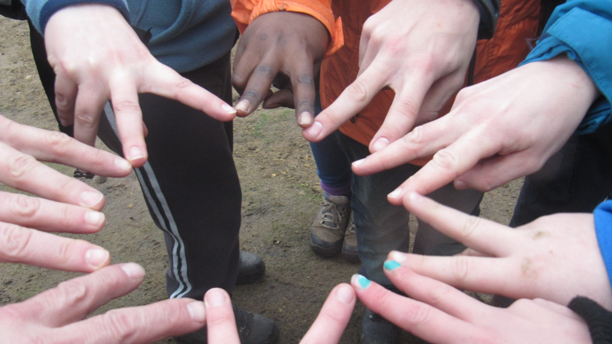 Young people from the YHA Posteller Group touching fingers