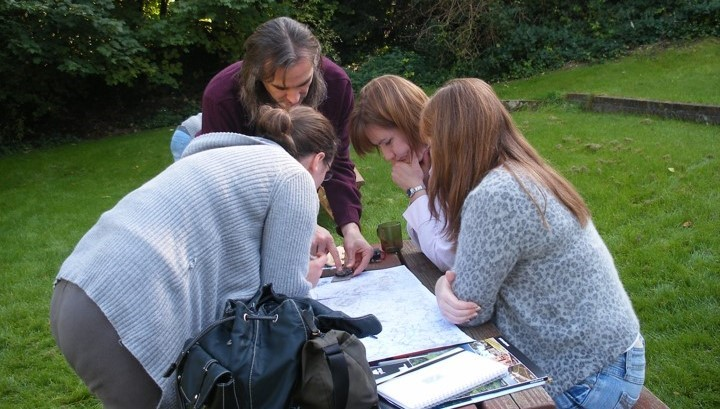 Posteller YHA Group Leaders practising map reading outside YHA Streatley Youth Hostel